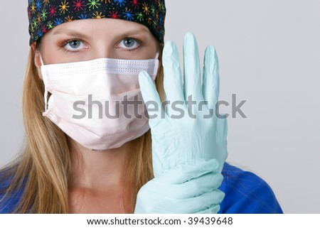 Medical personnel wearing a mask and gloves on white