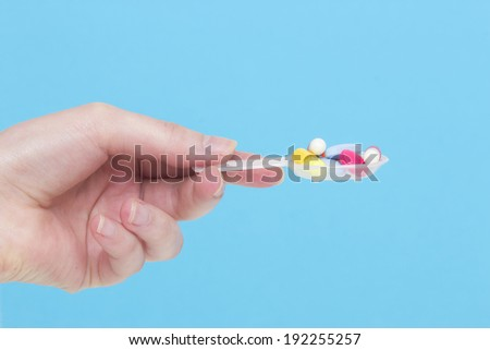 Medical pill in woman hand isolated on background