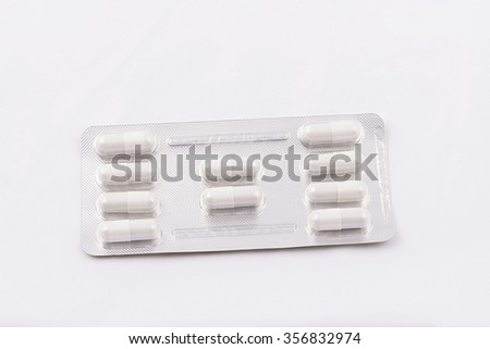 Medical pill tablet on white background. Isolated - stock photo