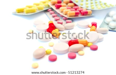 Medical pills and tablets isolated on white background. - stock photo