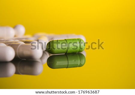 medical pills capsule on glass background