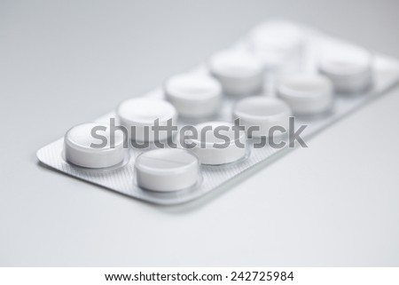 Medical pills in aluminium blister pack isolated on white. - stock photo
