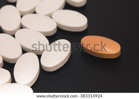 medical pills on a black background, pills macro shot, pills close-up view, pills photo - stock photo