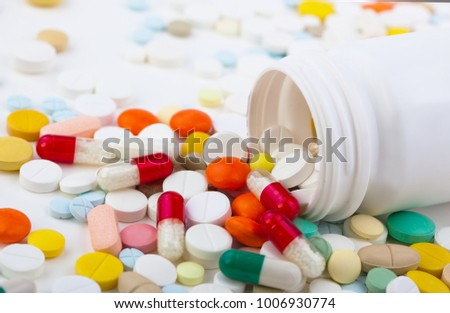 Medical pills on white background on the table in composition