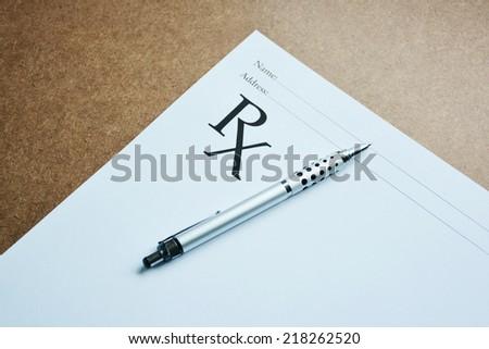 Medical prescription and pen. - stock photo