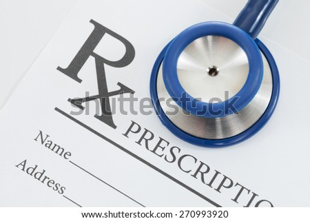 Medical prescription and stethoscope on table - studio shot - stock photo