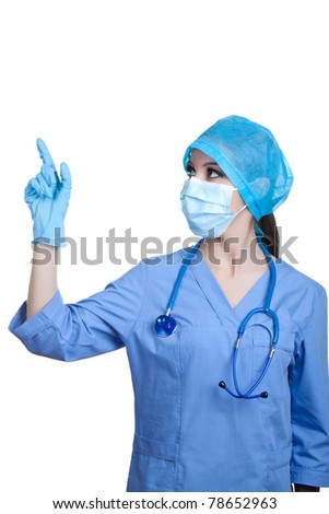 Medical professional person in blue gloves and mask : young nurse doctor portrait. Isolated on white background. Pointing finger to the side, presenting and showing copy space for product or text.
