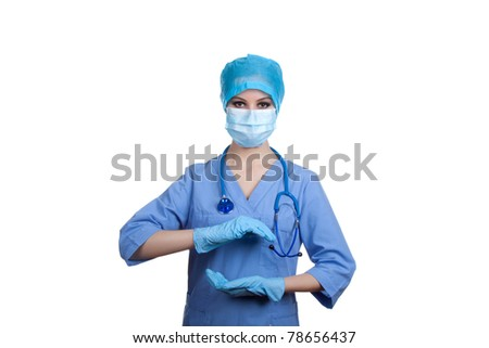 Medical professional person in blue gloves and mask : young nurse doctor portrait. Isolated on white background. holding something on his hand, presenting and showing copy space for product or text. - stock photo