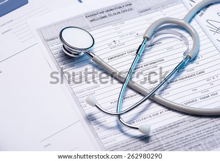 Medical questionnaire, stethoscope on blue background - stock photo