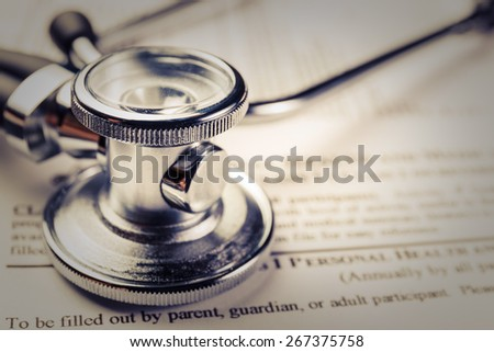 medical record form with a stethoscope - stock photo