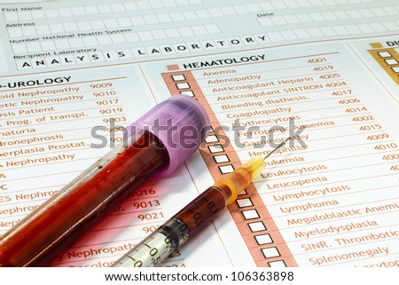 Medical report with a tube of blood and syringe - stock photo