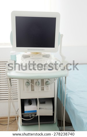 medical room with ultrasound diagnostic equipment