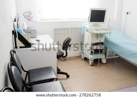 medical room with ultrasound diagnostic equipment - stock photo