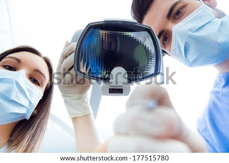 Medical scene of cute young woman at the dentist.  - stock photo