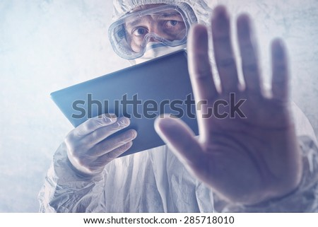 Medical Scientist Reading Internet Pages About MERS Virus on Figital Tablet Computer - stock photo