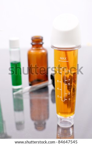 Medical Solution in Clear Sealed Bottle - stock photo