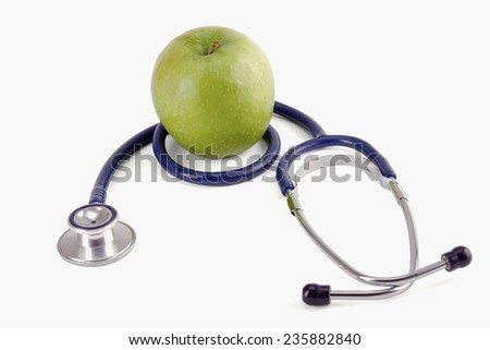 Medical stethoscope and apple - stock photo