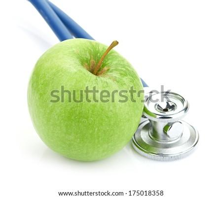 Medical stethoscope and apple isolated on white - stock photo