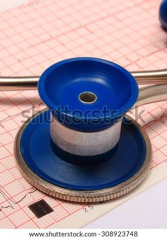 Medical stethoscope and electrocardiogram graph ekg heart rhythm, medicine concept - stock photo