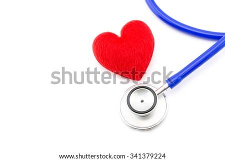Medical stethoscope and heart on white background. - stock photo
