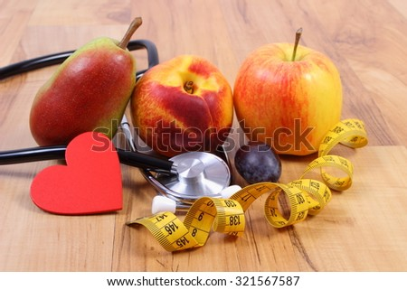 Medical stethoscope, fresh fruits and tape measure, concept of health care, healthy lifestyles and nutrition
