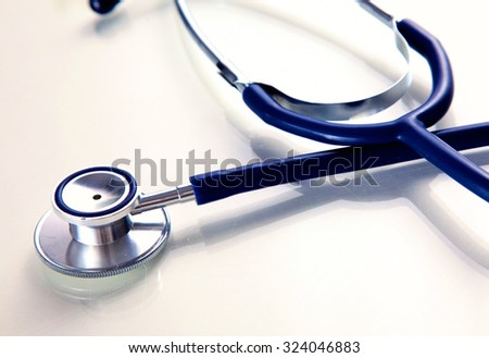 Medical stethoscope in white background