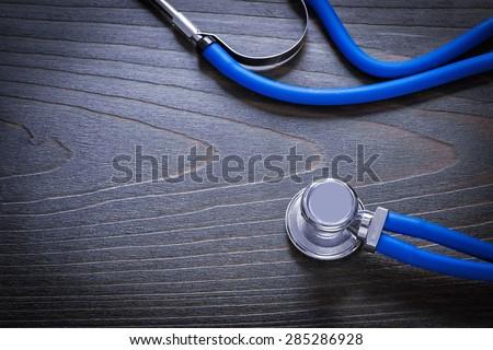 Medical stethoscope on vintage wooden board medicine concept  - stock photo