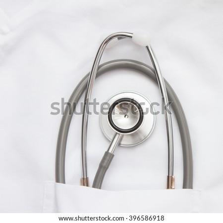 Medical stethoscope on white background. - stock photo