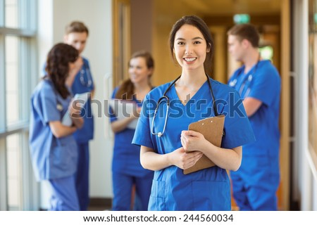 Medical student smiling at the camera at the university - stock photo