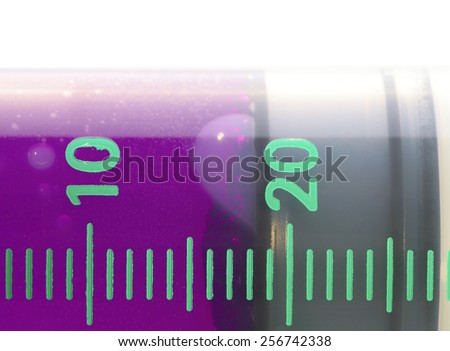Medical syringe with pink contents Isolated macro - stock photo