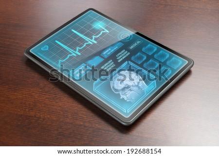 Medical tablet on desk - stock photo