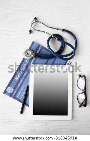 Medical tablet with screen empty screen on wooden table