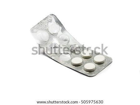 Medical tablets in packaging, are isolated on a white background