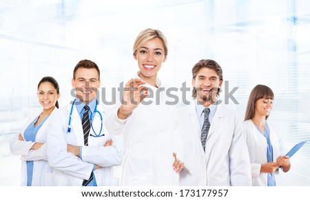 medical team doctor team happy smile excited, hold fist yes hand gesture wear white coat with stethoscope, group of people celebrating in hospital