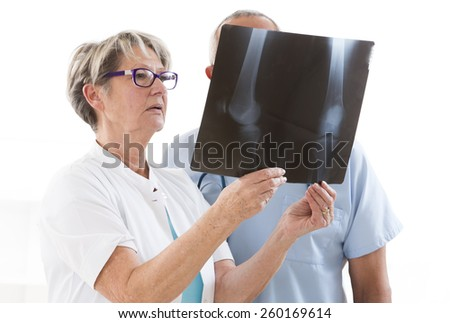 Medical team examining x-ray images - stock photo
