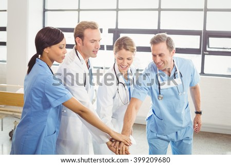 Medical team hands stacked over each other in hospital - stock photo