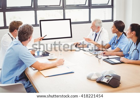 Medical team interacting at a meeting in conference room in hospital - stock photo