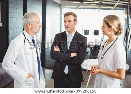 Medical team interacting with each other in hospital