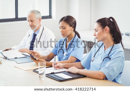 Medical team working in conference room in hospital