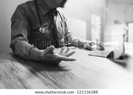 Medical technology concept. Doctor hand working with modern digital tablet dock screen computer with medical chart interface, Sun flare effect,black white