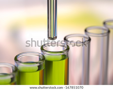 Medical test or research. Dispensing fluid into test tubes. - stock photo