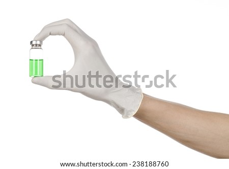 Medical theme: doctor's hand in a white glove holding a green vial of liquid for injection isolated on white background - stock photo