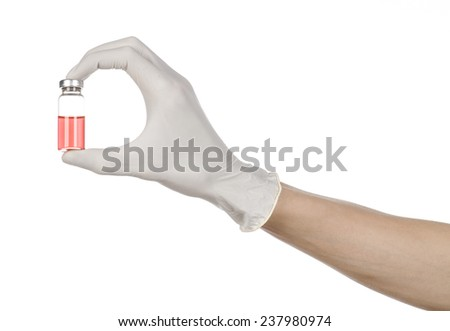 Medical theme: doctor's hand in a white glove holding a red vial of liquid for injection isolated on white background - stock photo