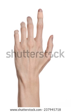 Medical theme: for a man's hand glued medical plaster first aid plaster advertising on a white background