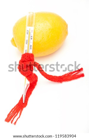 medical thermometer in warm knitted scarf with lemon - stock photo