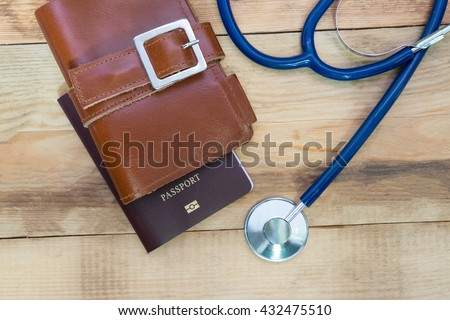 Medical tourism concept. Stethoscope with passport. - stock photo
