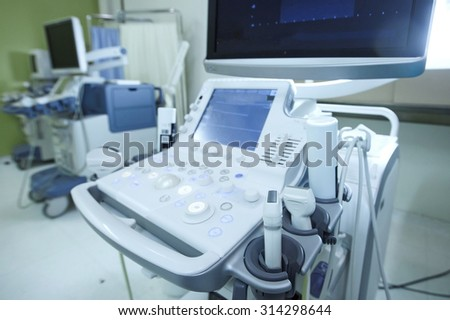 Medical ultrasound machine with linear probes in a hospital diagnostic room. Modern medical equipment, preventional medicine and healthcare concept.   - stock photo