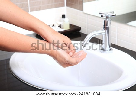 Medical wash hand cleaning with soap in the basin.