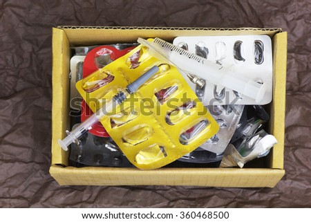 Medical Waste with Syringe, Empty Blister, Medicines, Capsules and Tablets. - stock photo