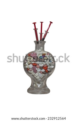 medicaments in a glass container, a heart, isolated on white - stock photo